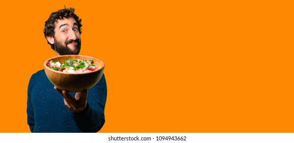 young cool and bearded man diet or breakfast concept isolated against orange background