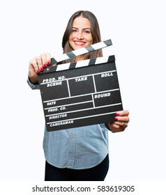 young cool girl with cinema clapper