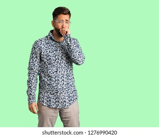 Young cool man coughing, sick due a virus or infection