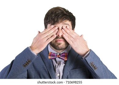 young cool man covering eyes