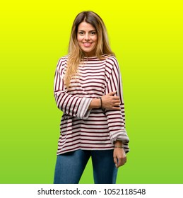 young cool woman posing against fresh summer green background