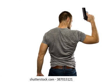 Young cop holding a gun in the right hand, seen from the back