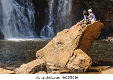 A young couple is admiring the majestic MacKenzie Falls in the Grampians Ranges - Halls Gap, Victoria, Australia, 10 October 2010