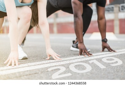 young couple afro-american man and european woman run together. A loving couple is run, engaged in sports, family values. finish 2018. Start to new year 2019, plans, goals, objectives