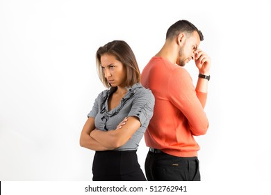 Young couple after argument offended back to back, not speaking to each other. Bad relationship concept. Man and woman in disagreement.