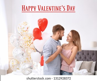 Young couple with air balloons in bedroom and text Happy Valentine's Day