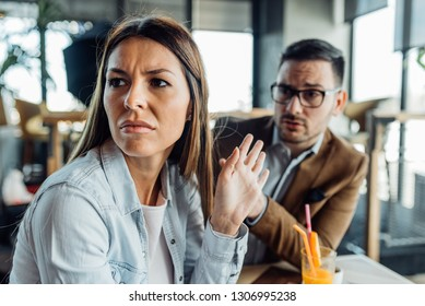 Young couple arguing in cafe