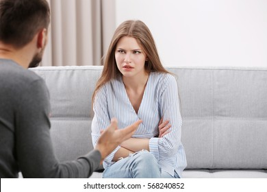 Young couple arguing at home