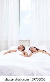 Young couple asleep in bed