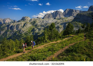 Young couple with backpacks traveling in Prokletije Mountains, Montenegro