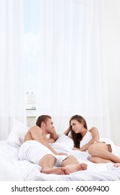 Young couple in bed in the bedroom