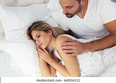Young couple in bed having problems and crisis