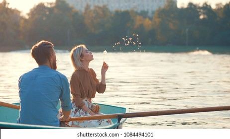Young couple in a boat on a date