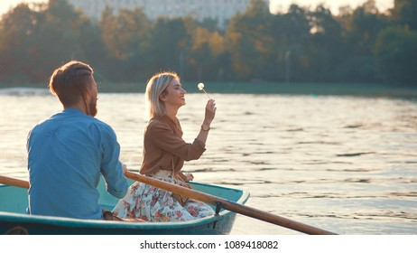 Young couple in a boat on a date on vacation