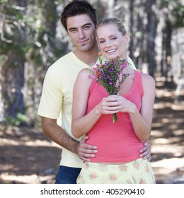 A young couple with a bouquet of flowers