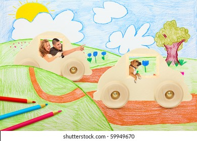 Young couple and boxer puppy driving through imaginary country side in wooden toy cars.
