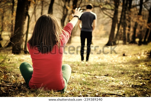 Young couple breaking up. Girl shouting out for boy