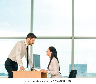 Young couple businessman on table solve theirs problem.Handsome asian business man show new options capability on tablet computer women sit at board in office room space type print text loot at screen