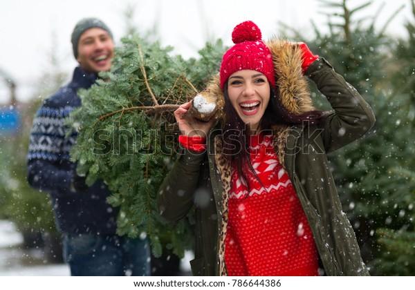 Young couple buying Christmas tree