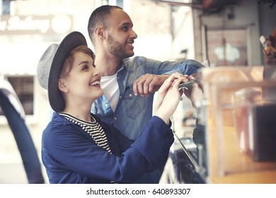 Young couple buying traditional street food