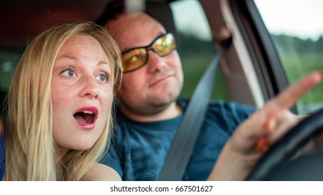 Young couple by car driving