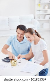 Young couple calculates Finance at home