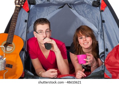 Young couple at the campground in a tent