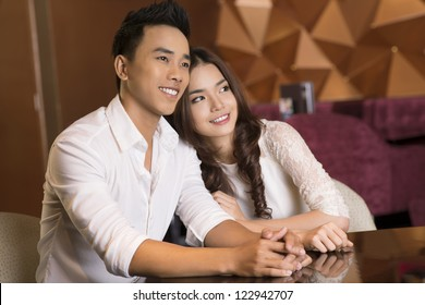 Young couple with candid smiles enjoying a moment together