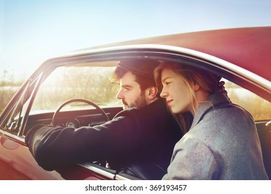 Young couple with car