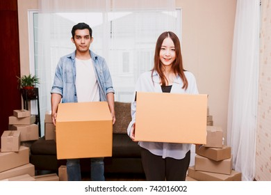 Young couple with cardboard box at home - Business online and delivery concept