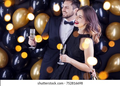 Young couple celebrating New Years eve with champagne.