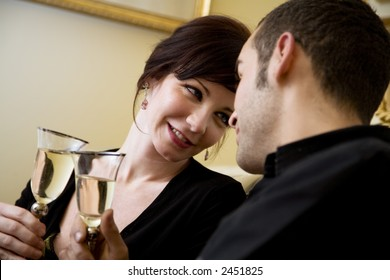 young couple celebrating some occasion and having fun