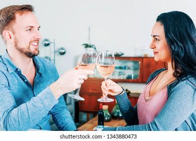 young couple celebrating toasting indoors
