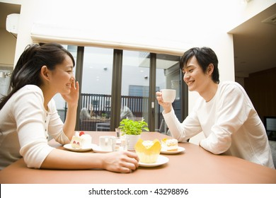 A young couple chatting and smiling in the kitchen