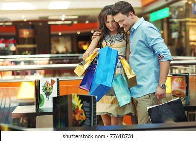 Young couple checking their shopping bags