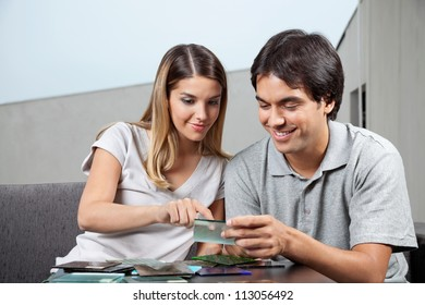 Young couple choosing between various glass tile swatches