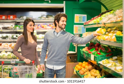 Young couple choosing food in a grocery store