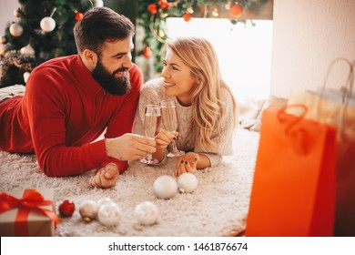 Young couple with a Christmas with champagne