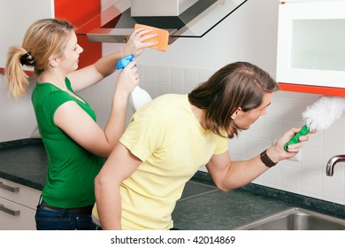 Young couple cleaning their apartment after moving in together