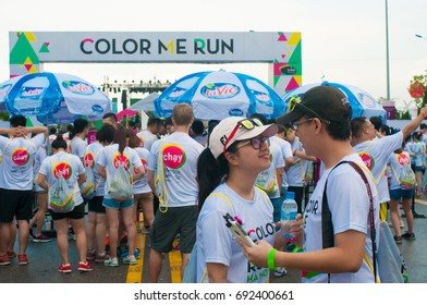 """Young couple at """"Color Me Run"""" event in HaNoi 2016, Viet Nam; Color Run is held annually in Vietnam.Public color run event in Hanoi capital city"""