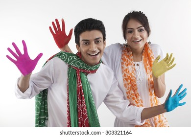 Young couple with colored palms