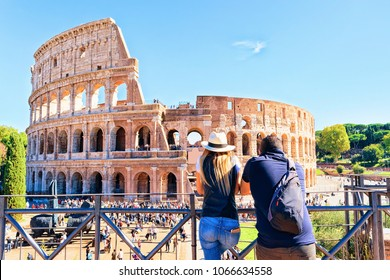Young couple at Colosseum in the old city center of Rome, Italy. It is amphitheater in Rome.