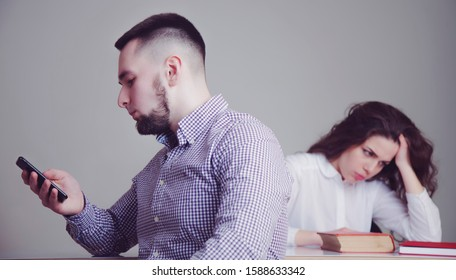 Young couple in conflict, quarrel of the husband with the wife. Relationships problems. (Love, hate, unhappy, stress, negative emotion concept)