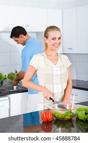 young couple cooking food in kitchen