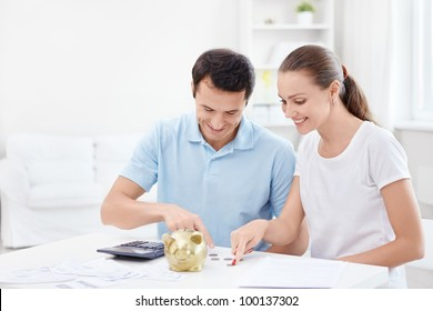 Young couple counts money