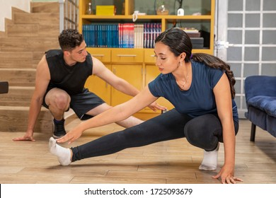 Young couple in COVID-19 disease quarantine. Couple exercising at home