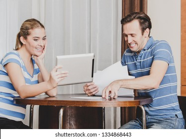 Young couple creating a bank account on line. They don't need paper documents.
