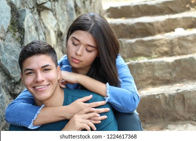 Young couple cuddling close up