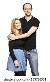 Young couple cuddling and smiling on white background smiling
