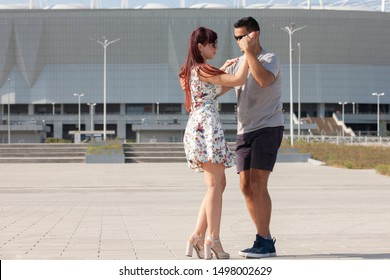 A young couple of dance instructors teaching salsa and bachata. Portrait.